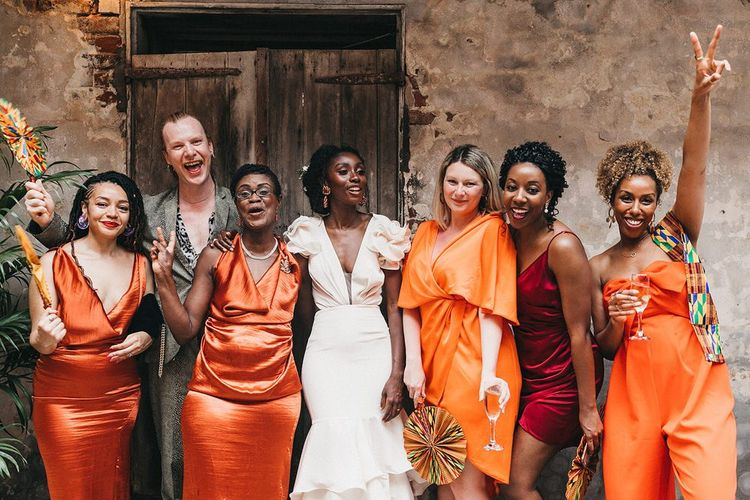 Stylish Bridal Party with Bridesmaids in Different Orange Dresses