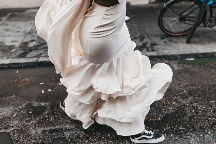 Stylish Bride in Ruffled Skirt Wedding Dress and Vans Wedding Shoes