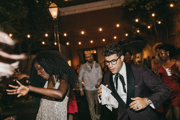 Bride with Curly Hair and Silver Sequin Dress and Groom in Burgundy Suit