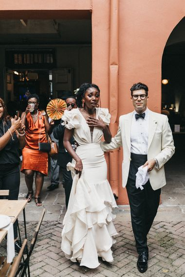 Emotional Bride and Groom as they Enter Their Beautifully Decorated Wedding Reception