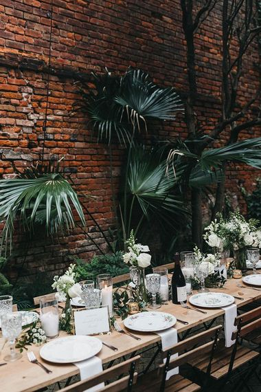 White and Green Wedding Reception Table Decor with Plants, Flowers and Floral Tableware