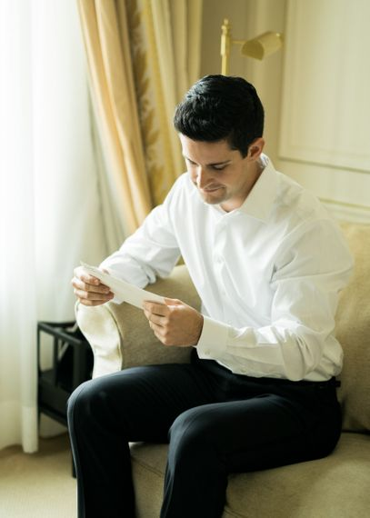 Groom Reading a Letter on the Morning of the Wedding