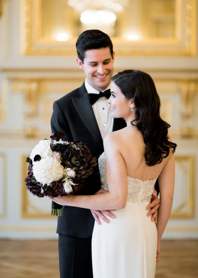 Groom Holding His Brides Waist in an Off The Shoulder Wedding Dress