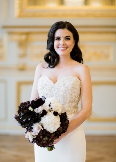 Glamorous Bride in a Sweetheart Neckline Tara Keely Wedding Dress with Black and White Bridal Bouquet