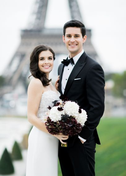 Glamorous Bride in Tara Keely Wedding Dress with Black and White Wedding Bouquet and Groom in Black Tie Suit