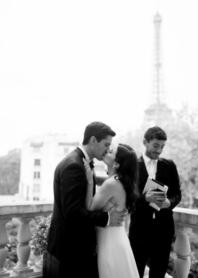 Bride and Groom Kissing after their Paris Rooftop Wedding Ceremony