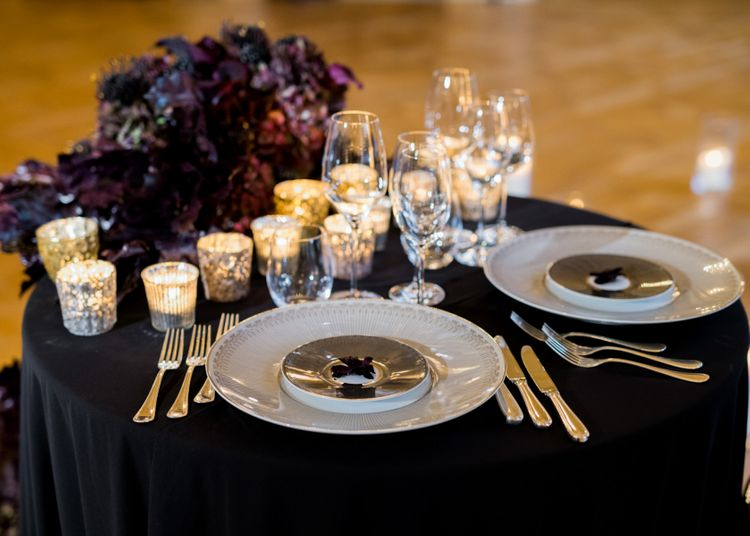 Sweetheart Table with Black Table Cloth, Wedding Flowers and Romantic Candle Light