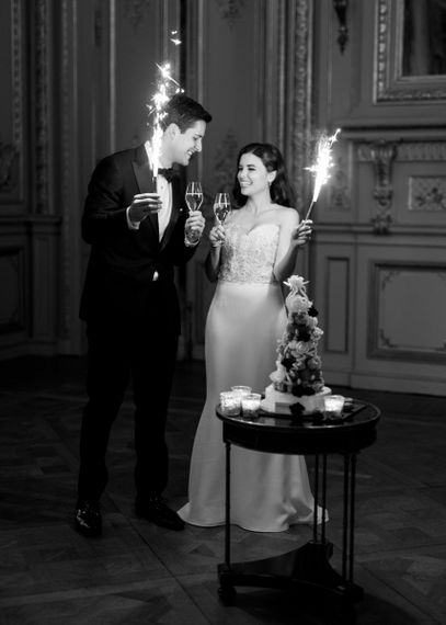 Bride and Groom Holding Cake Sparklers