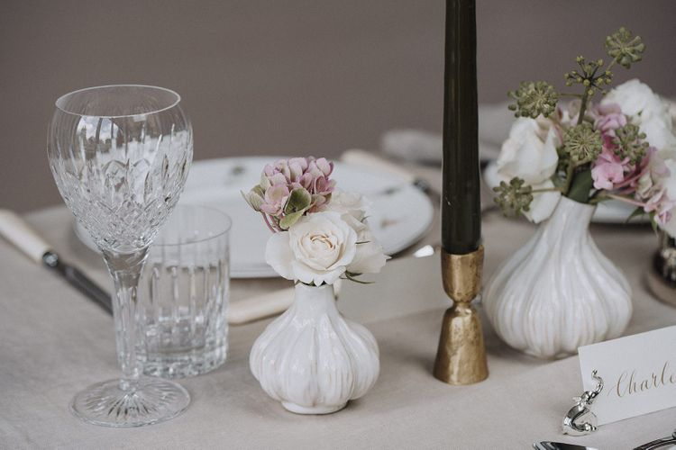 White ceramic bud vases for tablescape styled by By Cheani