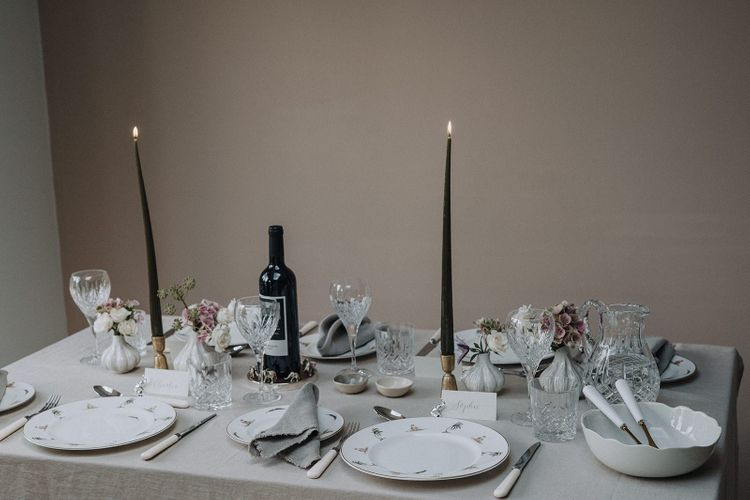 Fine china tableware and serving bowl, with gold candlestick and cut glass crystal glasses