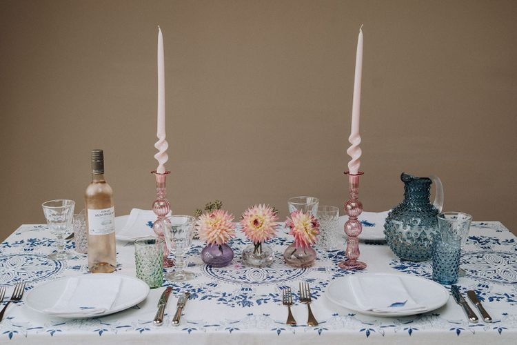 Colourful tablescape with printed linens and glass tableware