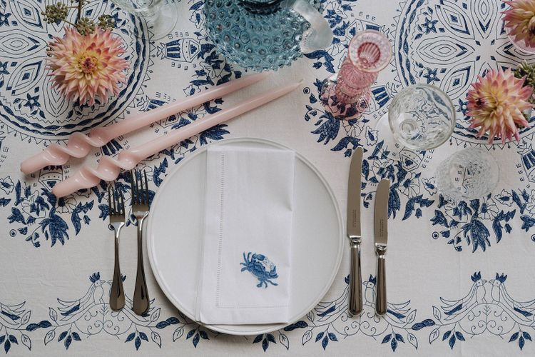 printed table cloth and napkin with coloured glassware