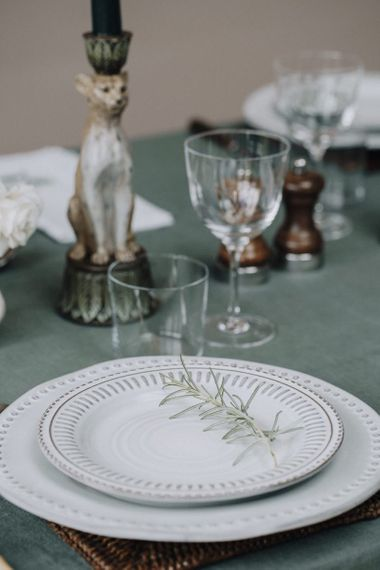 green table linen and printed tableware