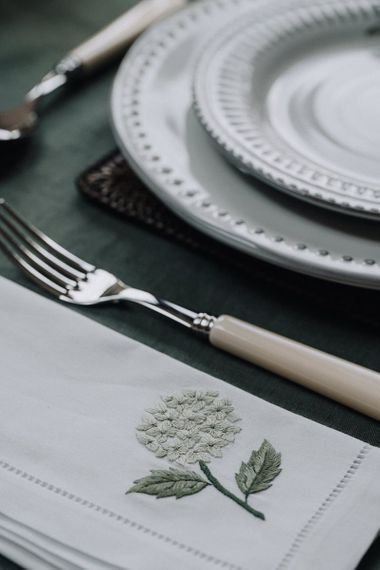 embroidered table linen and ivory cutlery