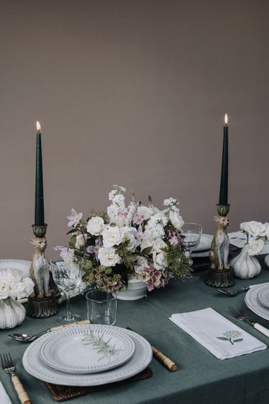 Floral centrepiece and taper candles for elegant tablescape