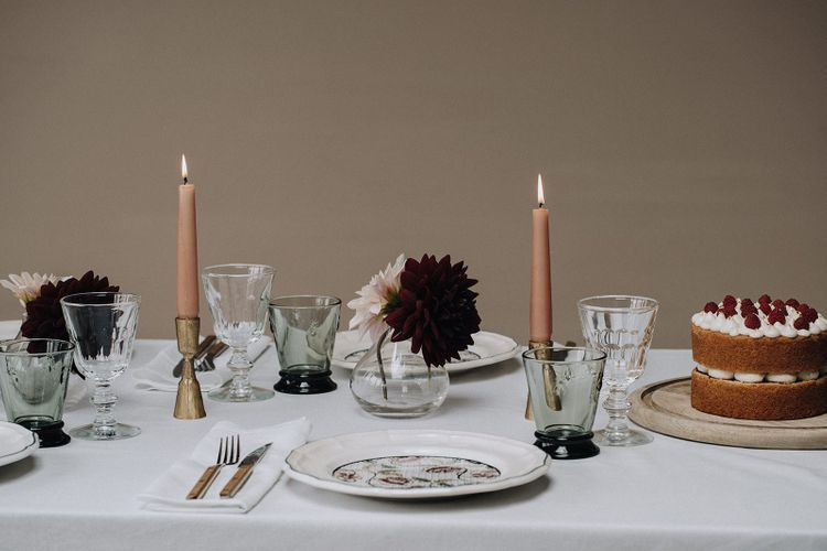 Gold candlestick holder and dusky pink taper candles