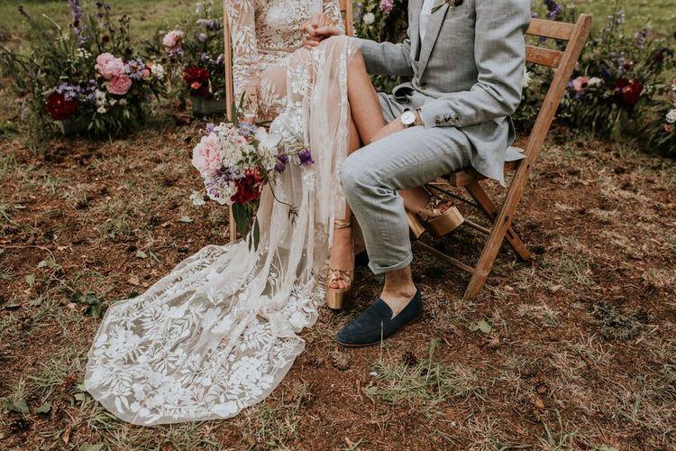 Gold bride shoes with lace bride dress