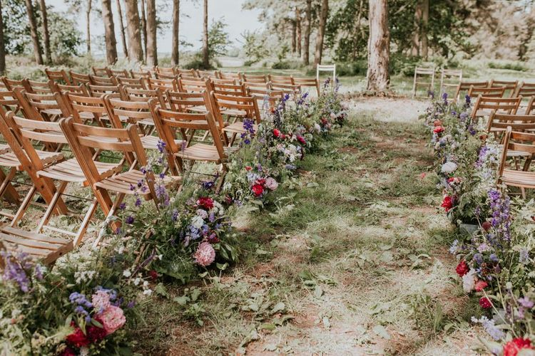 Aisle and altar wedding flowers and decor at Norfolk wedding venue