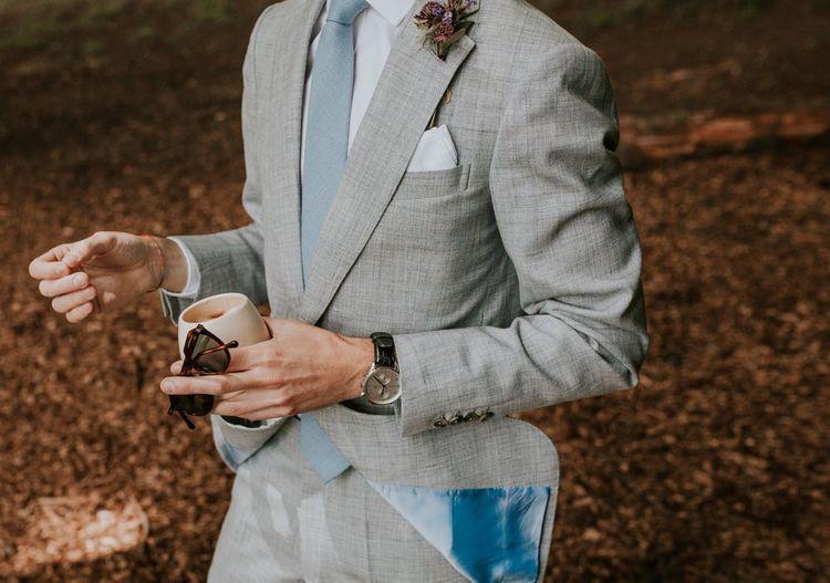Grey grooms suit with blue tie
