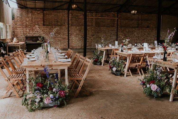 Barn wedding reception with pink flower decor