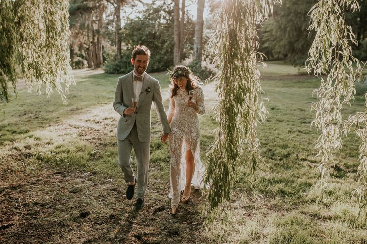 Bride and groom walk through the grounds of the Norfolk wedding venue