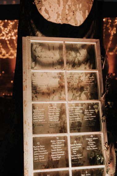 Window pane table plan at romantic celebration with destination wedding planner help