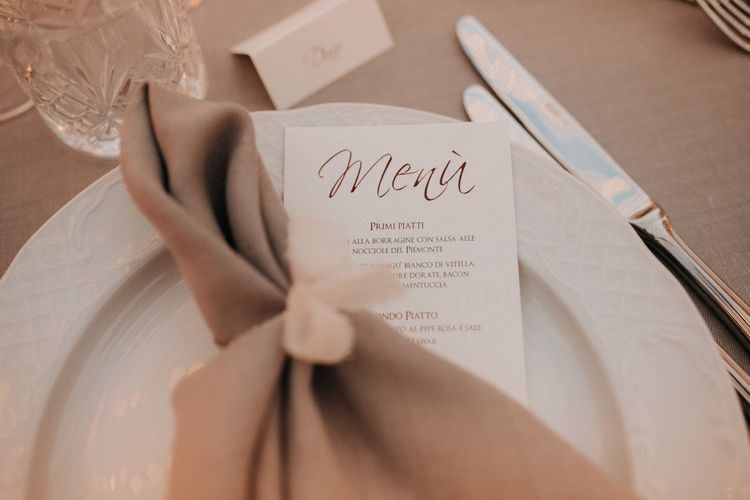 Beautiful place setting at romantic destination wedding