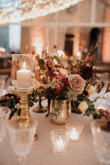 Stunning wedding table decor with blush roses and candles