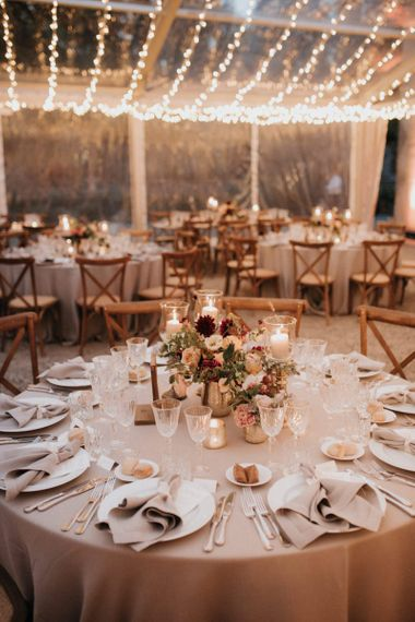 Clear-span marquee decorated by destination wedding planner with candles and roses