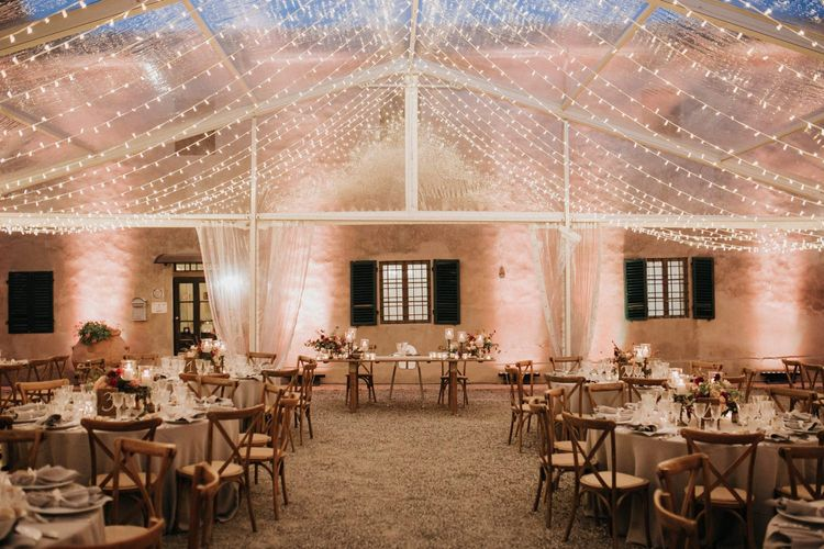 Fairy light canopy draping from ceiling of clear span marquee