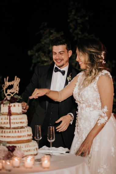 Bride and groom cut the drip wedding cake at destination wedding
