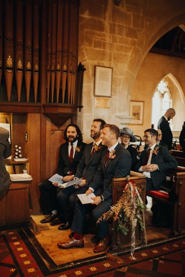 Groom and guests wait for bride's arrival