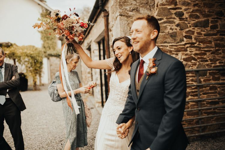 Bride in Maggie Sottero wedding dress with Autumnal bouquet