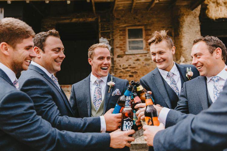 Groomsmen in Blue Suit with Floral Ties