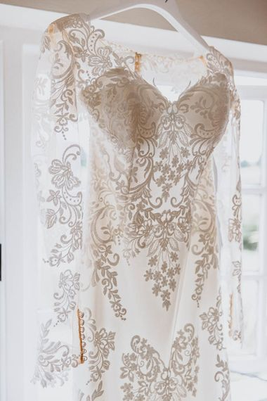 Long Sleeve Lace Sincerity Bridal Wedding Dress Hanging at the Window
