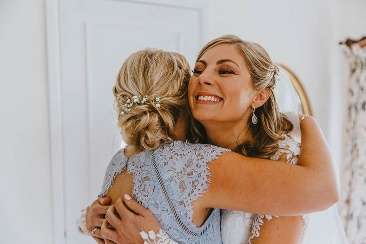 Bridesmaids in Blue Lace Dress Hugging The Bride on Wedding Morning