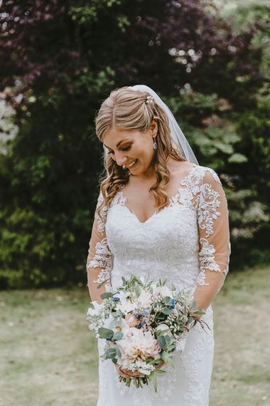 Bride in Lace Sincerity Brides Wedding Dress with Long Sleeves, Pastel Bouquet and Veil