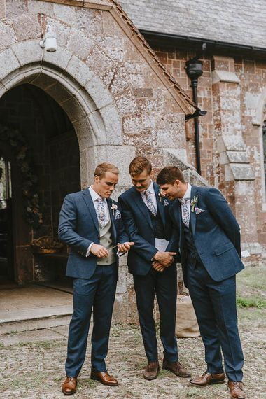 Groomsmen Outside the Church in Navy Suits, Grey Waistcoat and Floral Ties