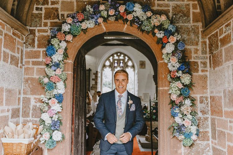 Floral Church Entrance Wedding Flower Arch Made up of Pastel Pink and Blue Hydrangea Flowers