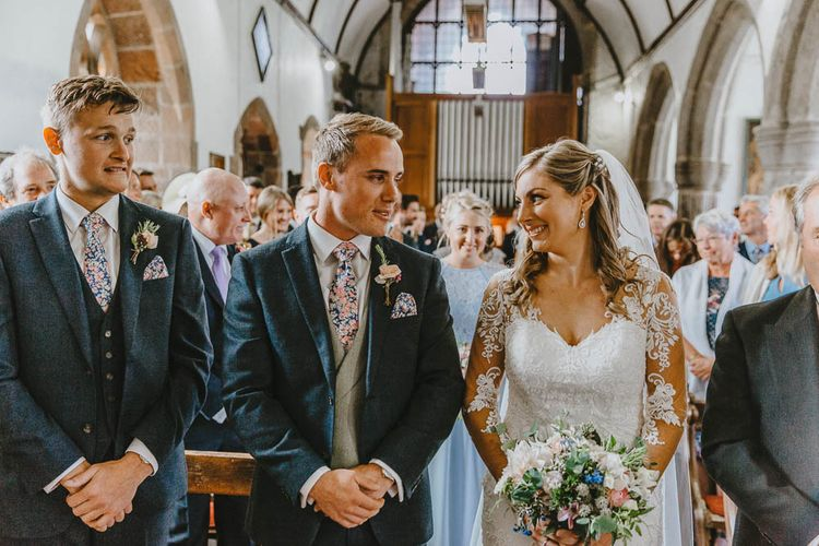Church Wedding Ceremony with Bride in Lace Sincerity Bridal Wedding Dress and Groom in Blue Ted Baker Suit