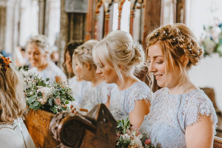 Church Wedding Ceremony with Bridesmaids in Pale Blue Lace Dresses from Debenhams