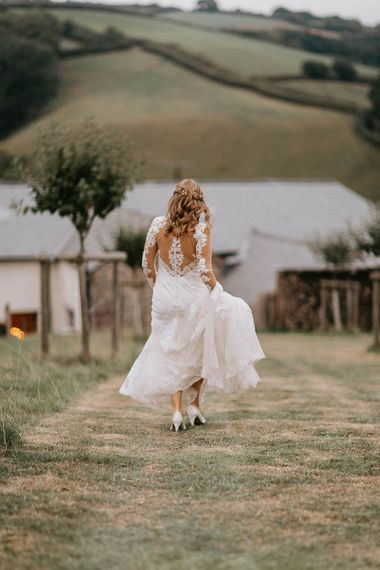 Bride in Lace Sincerity Bridal Wedding Dress with Illusion Back Detail and Long Sleeves