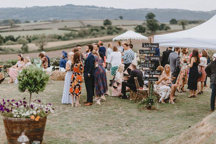 Wedding Guests Enjoying Outdoor Drinks Reception