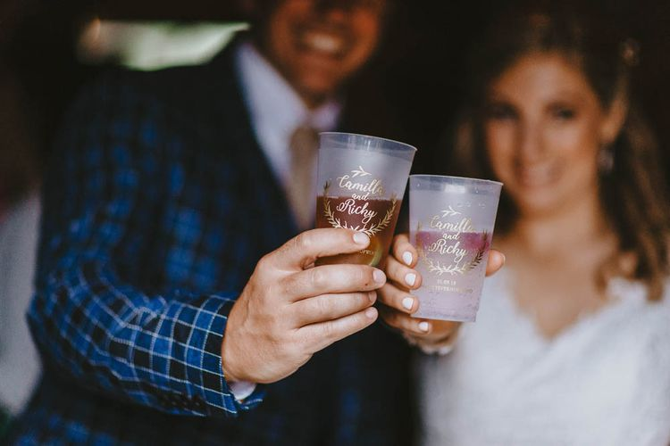 Bride and Groom Toasting with Personalised Wedding Glasses