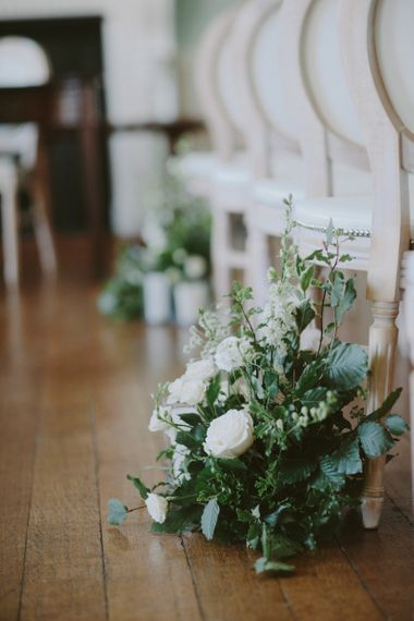 Ceremony flowers at Kirtlington Park wedding