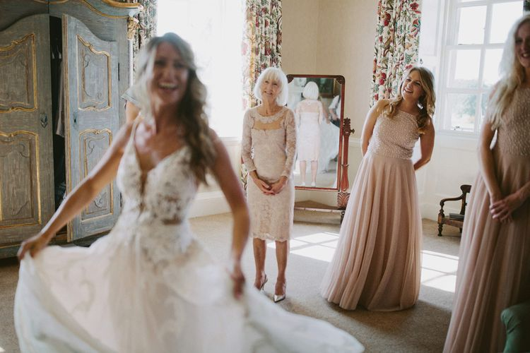 Bride shows bridesmaids dress