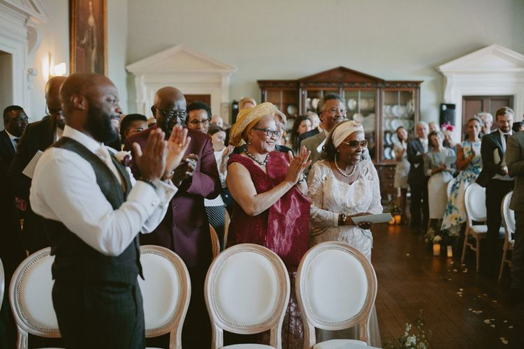 Guests applause wedding ceremony