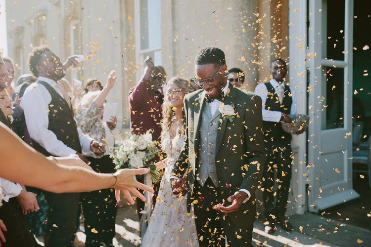 Confetti exit for bride and groom at Kirtlington Park wedding