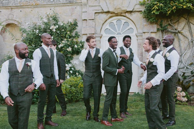 Groomsmen in matching outfits