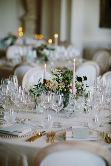 Candles and flower centrepieces at Kirtlington Park wedding